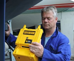 Guy Nicholls, marine surveyor, using a moisture meter on a yacht in Hamble, Hampshire