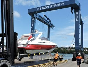 Saxon Wharf, Southampton, a Marine Surveyor surveying a Sunseeker Superhawk in the slings