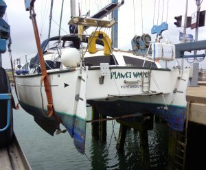 Heavenly Twins HT27 catamaran in the slings for a Marine Survey at Southsea Marina, Portsmouth