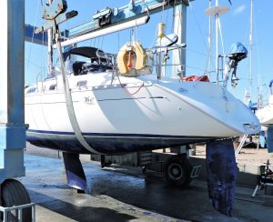 Dufour 36 Yacht Marine Survey in the slings at Lymington Yacht Haven