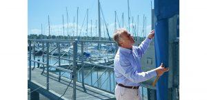 Guy Inspecting Rudder Solent Marine Surveys